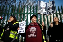 Supporters of WikiLeaks founder Julian Assange protest outside Woolwich Crown Court, ahead of a hearing to decide whether…