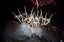 Fireworks light the sky at Mount Rushmore National Memorial, Friday, July 3, 2020, near Keystone, S.D., after President Donald…