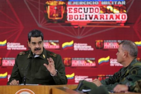 """Handout picture released by the Venezuelan Presidency showing Venezuela's President Nicolas Maduro (L)  speaking next to Defence Minister Vladimir Padrino during a meeting with members of the Bolivarian National Armed Forces (FANB) to present the balance of military exercises of the 'Bolivarian Shield 2020 Operation' in Caracas, on February 17, 2020. (Photo by MARCELO GARCIA / Venezuelan Presidency / AFP) / RESTRICTED TO EDITORIAL USE - MANDATORY CREDIT """"AFP PHOTO / VENEZUELA'S PRESIDENCY / MARCELO GARCIA"""" - NO MARKETING - NO ADVERTISING CAMPAIGNS - DISTRIBUTED AS A SERVICE TO CLIENTS"""