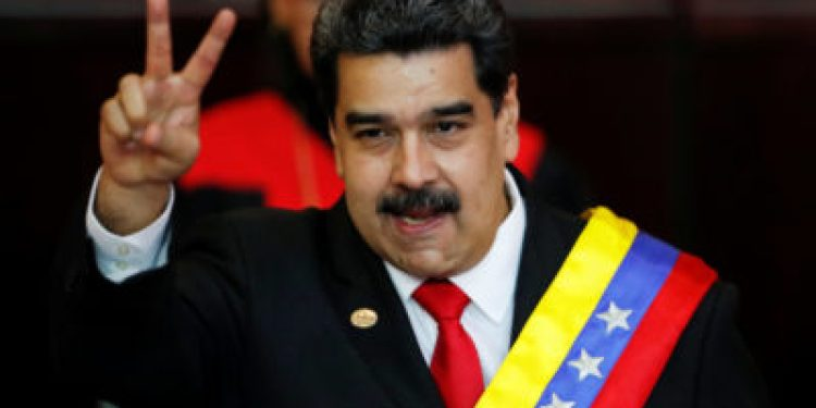 FILE PHOTO: Venezuelan President Nicolas Maduro gestures after receiving the presidential sash during the ceremonial swearing-in for his second presidential term, at the Supreme Court in Caracas, Venezuela Jan. 10, 2019. REUTERS/Carlos Garcia Rawlins/File Photo