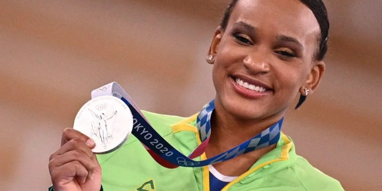 Brazil's Rebeca Andrade poses with her silver medal during the podium ceremony of the artistic gymnastics women's all-around final during the Tokyo 2020 Olympic Games at the Ariake Gymnastics Centre in Tokyo on July 29, 2021. (Photo by MARTIN BUREAU / AFP) (Photo by MARTIN BUREAU/AFP via Getty Images)
