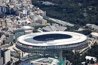 This aerial view taken on July 19, 2021 shows the Olympic Stadium, the main venue for the Tokyo 2020 Olympic Games, in Tokyo. (Photo by Yuki IWAMURA / AFP)