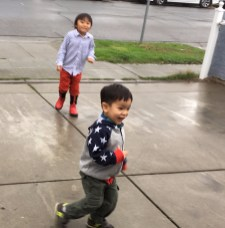 Partying with family in San Jose (image is of Collin and distant cousin playing on the driveway outside in the rain.