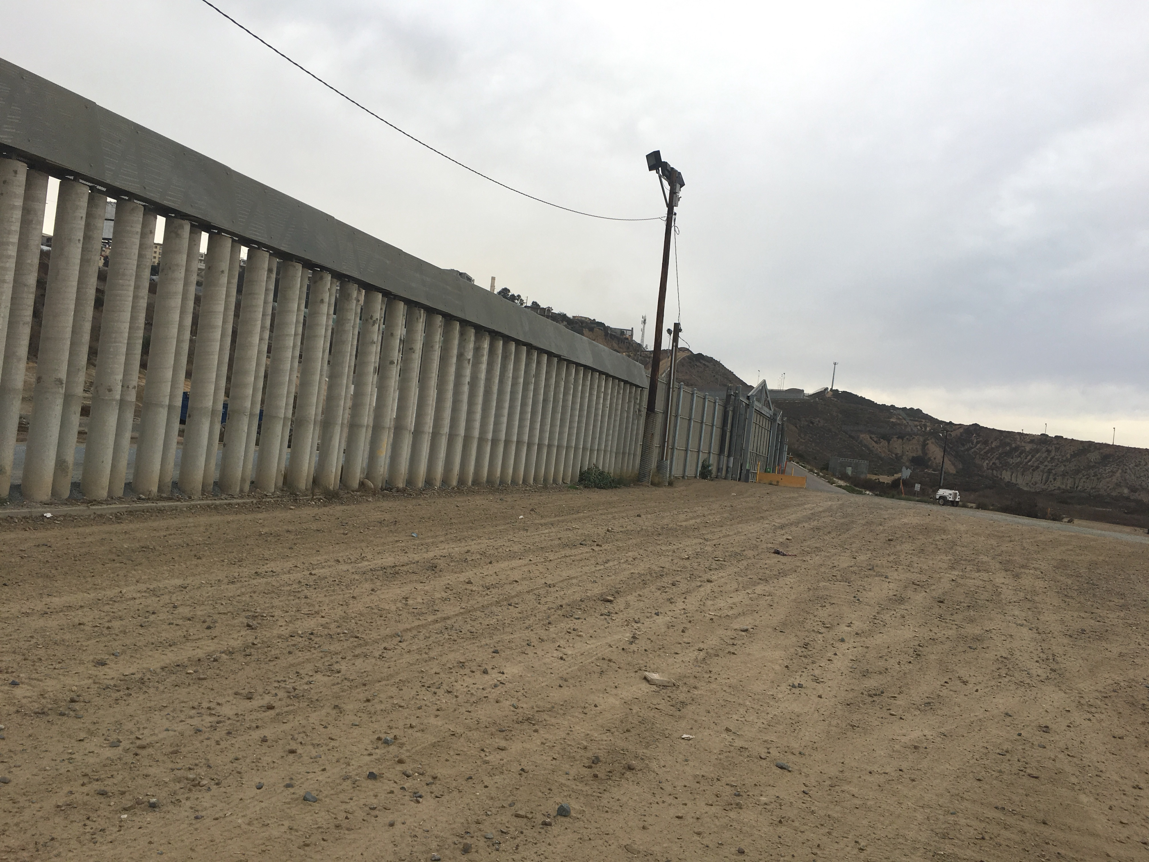 Various images of the US/Mexico Border on the US side. It is highly militarized with some sections having 2-3 border fences.