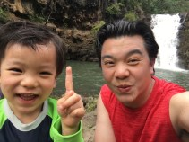 Image of me and Collin in front of a beautiful waterfall on our Hawaii trip. This was right before we braved our way into the water.