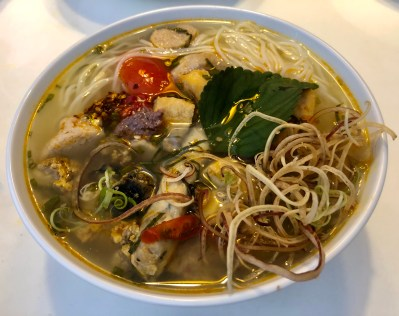 Bun Rieu with garnish of shredded banana blossom