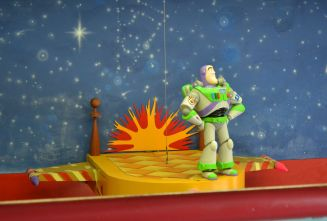 """Buzz """"guarding"""" the registers at Pizza Planet"""