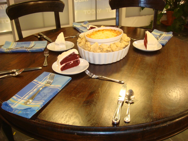 Table with Cheese Dip and Velvet cake set for four.