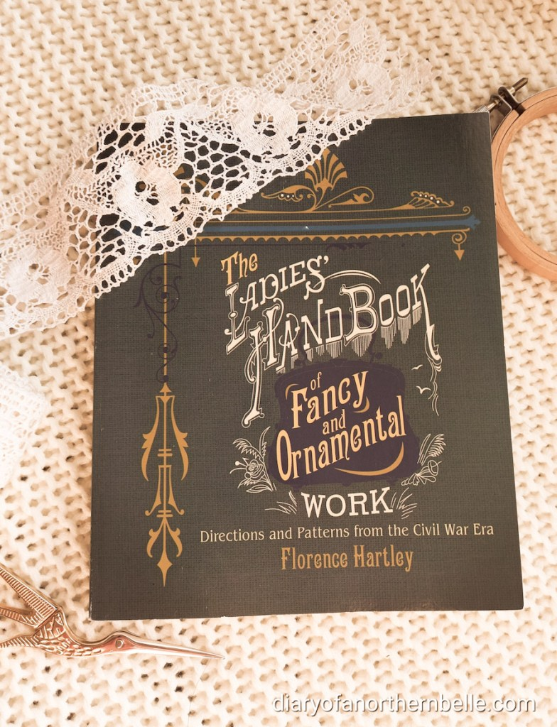 """cover of """"The Ladies' Handbook of Fancy and Ornamental Work"""" by Florence Hartley"""