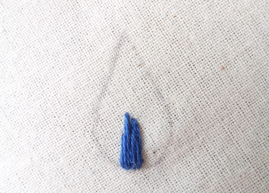 Waste knot has been snipped off the good side of fabric