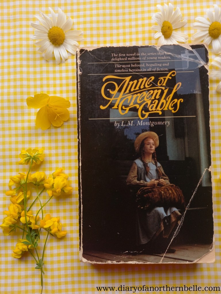 Anne of Green Gables book copy surrounded by summer flowers