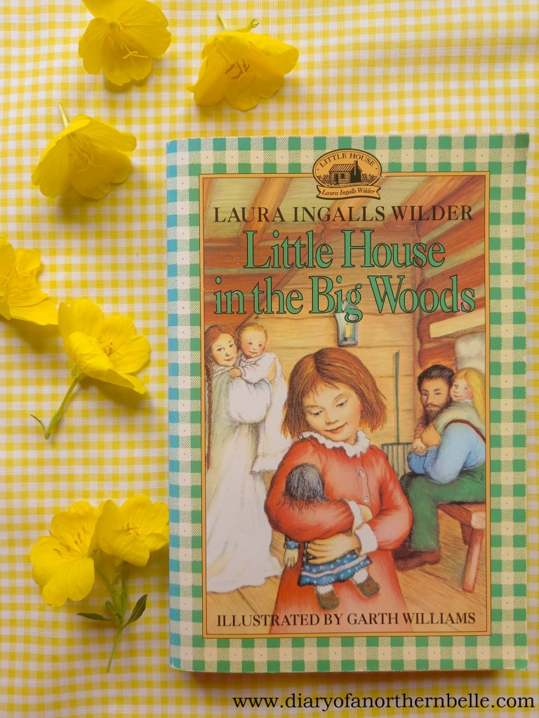 Little House in the Big Woods book copy with yellow buttercups