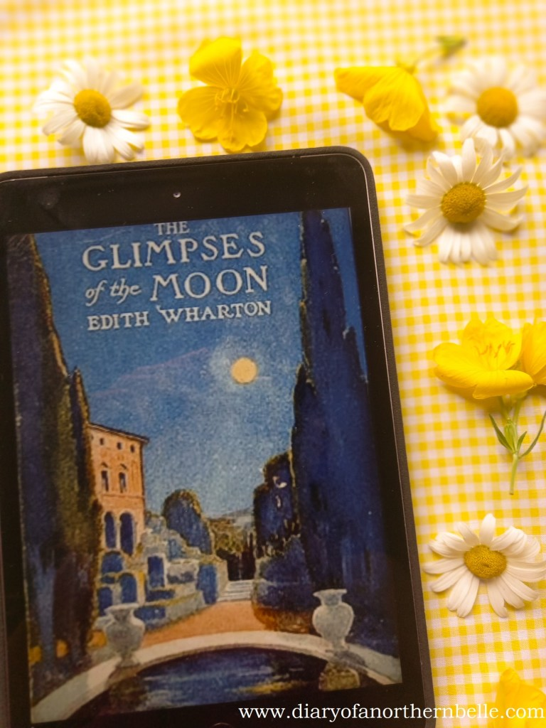 The Glimpses of the Moon bookcover on iPad surrounded by daisies