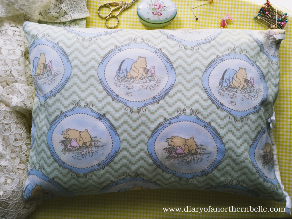 non-embroidered side of the pillow showing winnie-the-pooh fabric