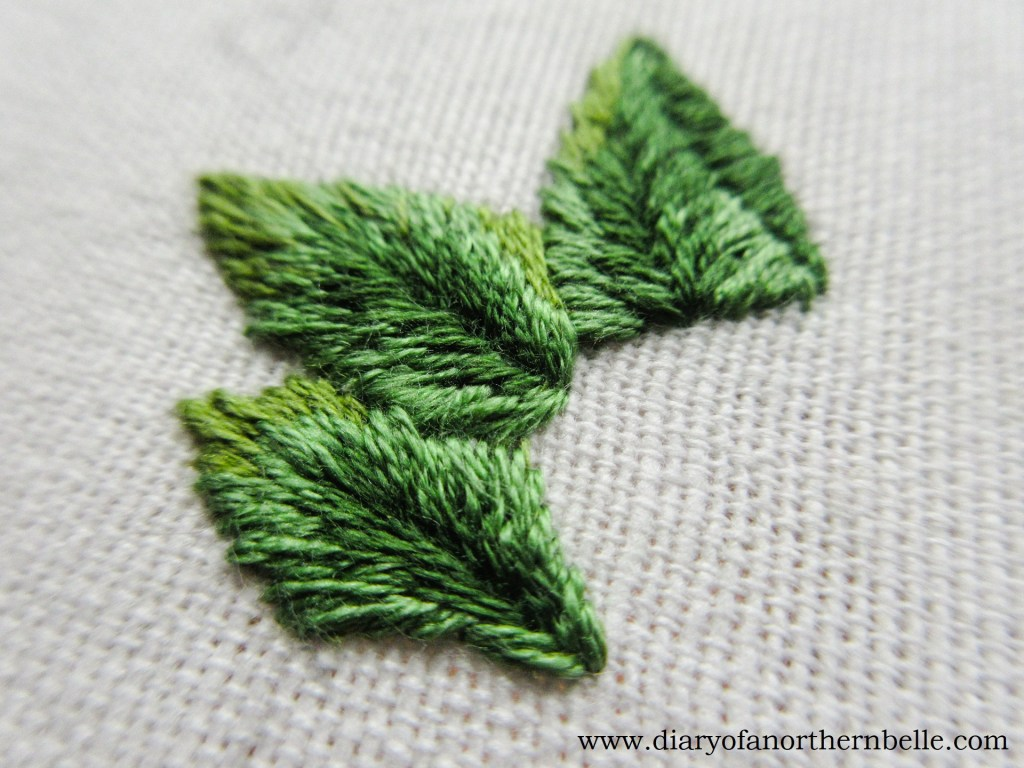 finished cluster of wild rose leaves embroidered in long & short stitches