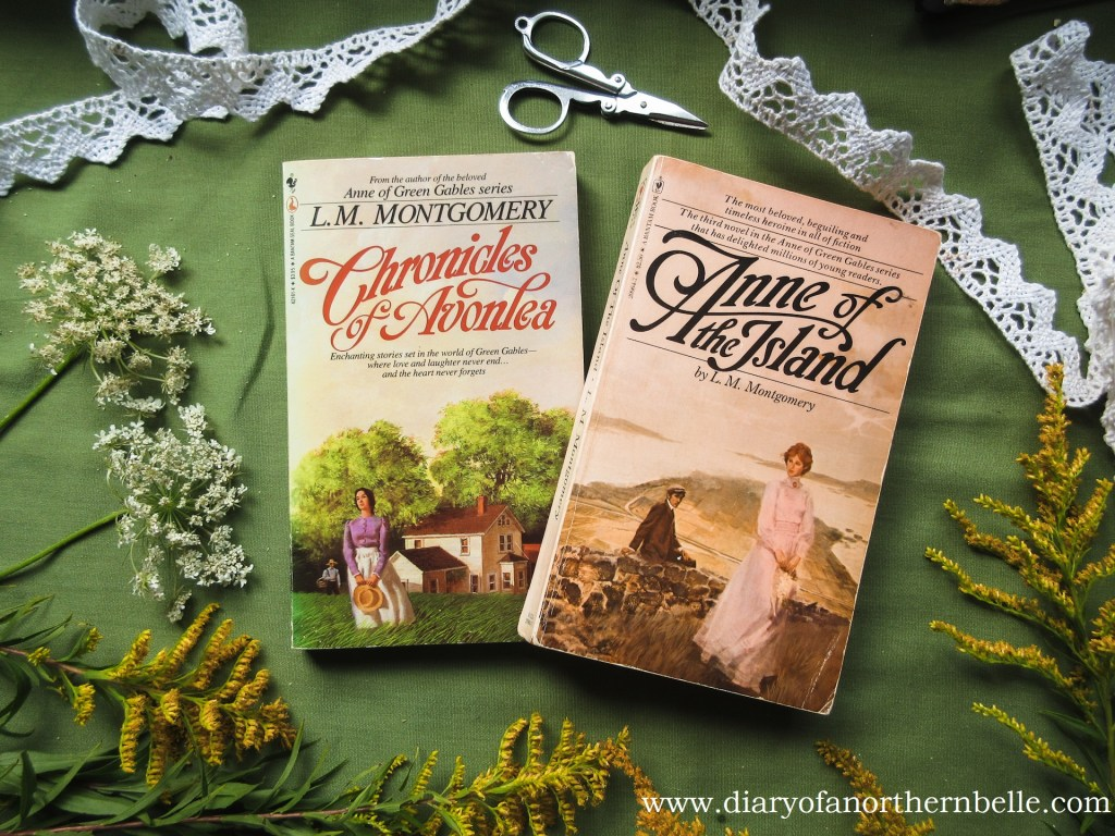 paperback copies of Chronicles of Avonlea and Anne of the Island books surrounded by wildflowers and lace