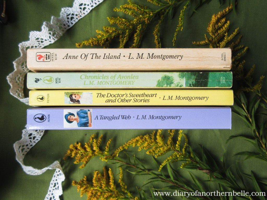stack of l.m. montgomery books with wild goldenrod