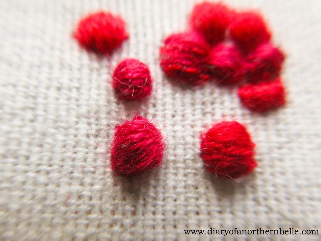 covered cotton ball with satin stitch to form a currant berry