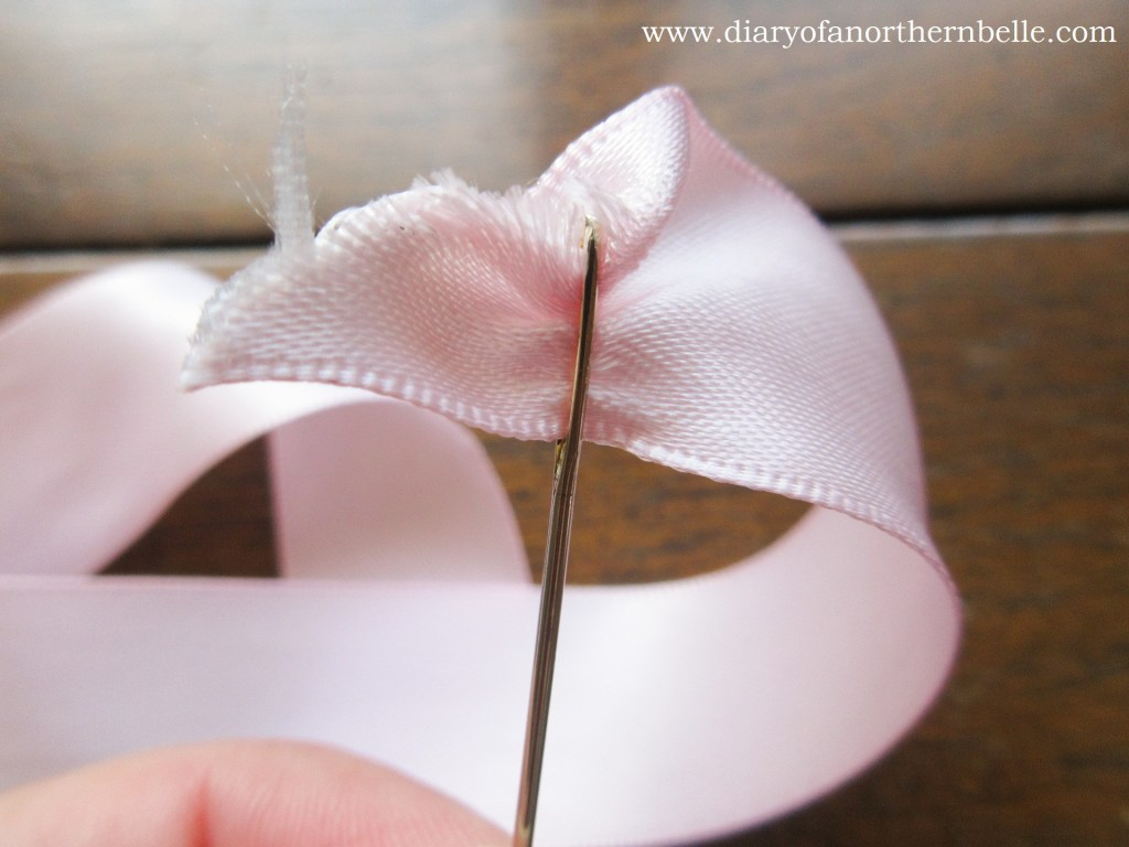 trying to thread the large ribbon through a chenille needle