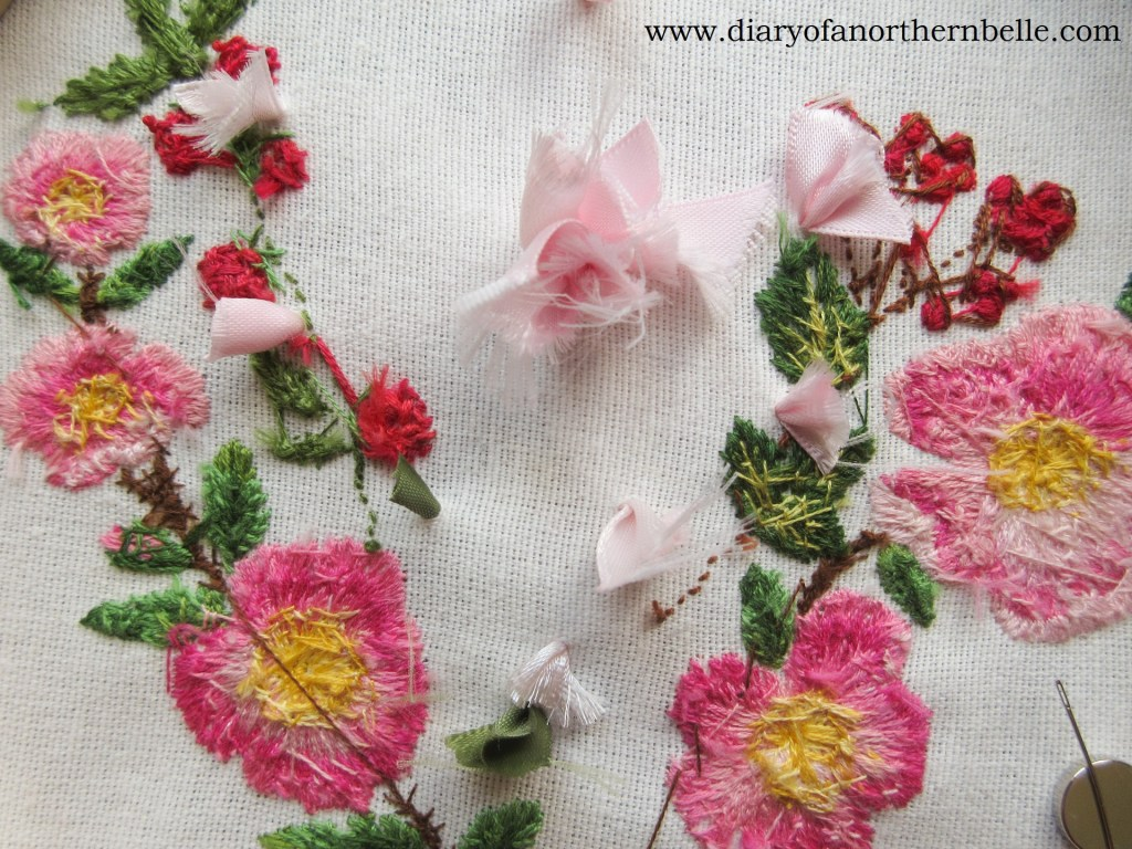 backside of embroidery work to show the ribbon ends to secure