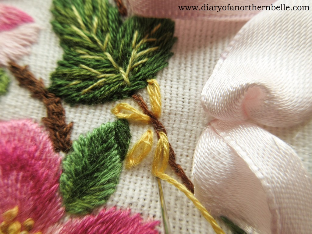 lazy-daisy stitches being worked to create flower petals