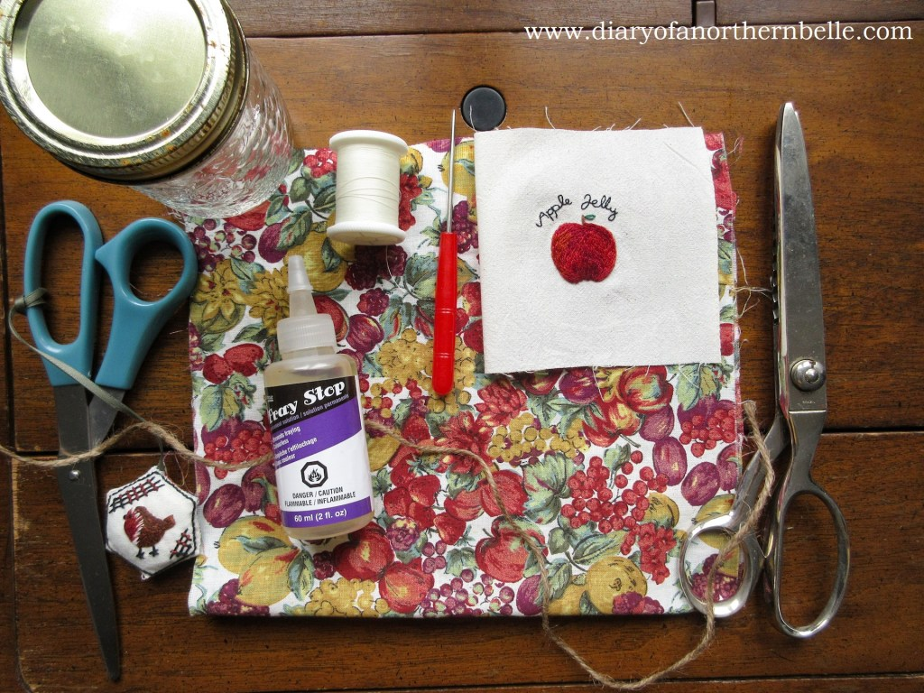 materials you need to make the jar bonnets: fabric, thread, mason jar, sewing scissors, pinking shears, fray check glue, tailor's awl, sewing thread and embroidered apple jelly pattern