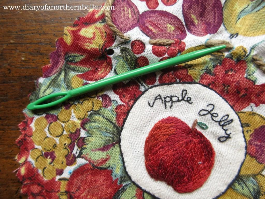 knitting bodkin to make holes bigger around the jar bonnet