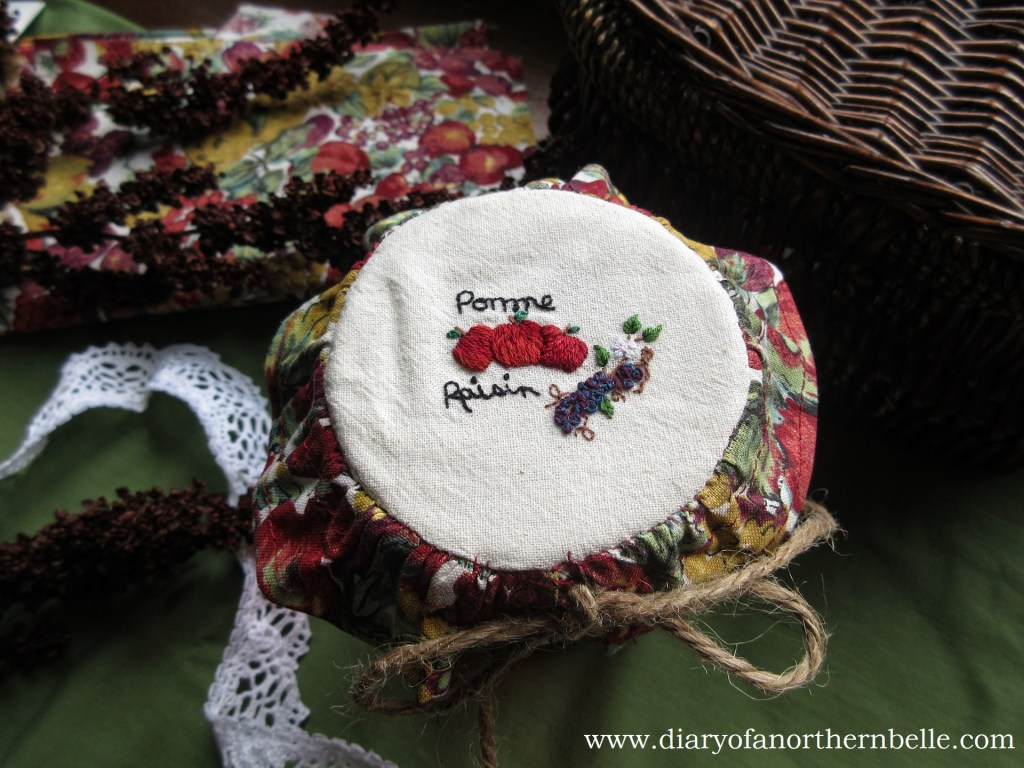 top view of embroidered jar bonnet with pomme raisin embroidery
