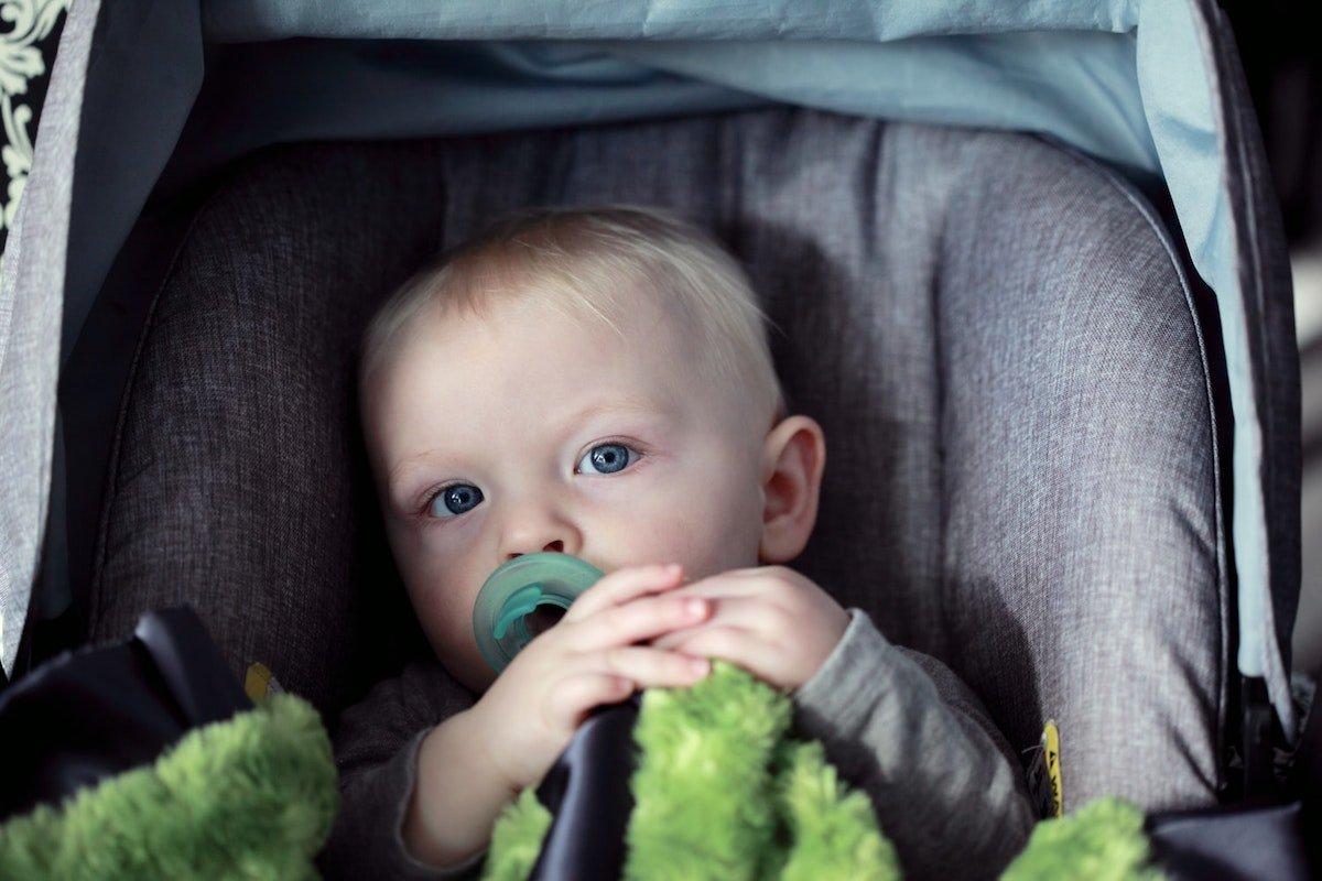 boy sitting in car seat