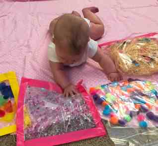 baby with sensory bags