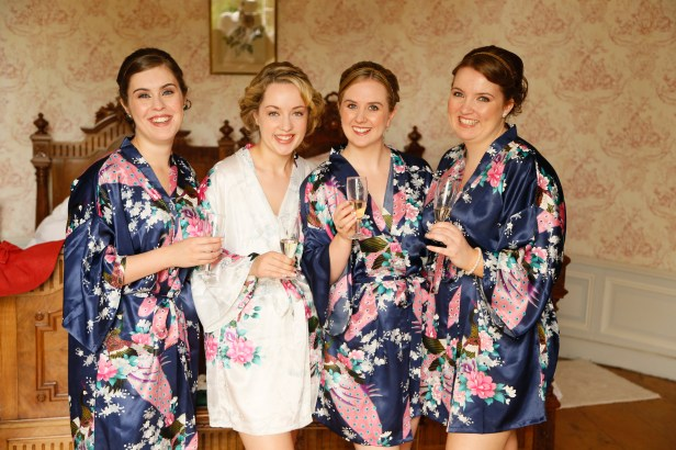 Bride and bridesmaids in dressing gowns in a French chateau