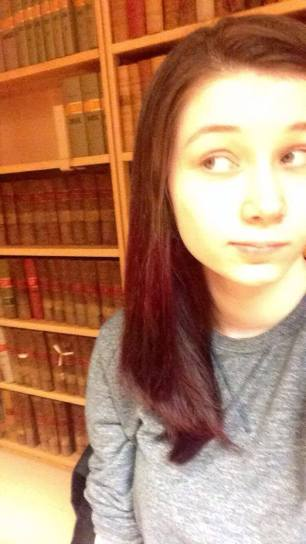 Studying super hard in the college library...
