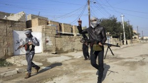 File photo of gunmen fighters walking with their weapons in the streets of the city of Ramadi