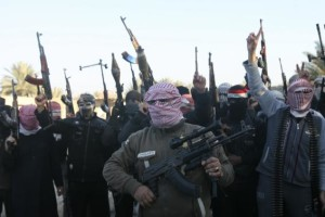 File photo of masked Sunni gunmen chanting slogans during protest against Iraq's Shi'ite-led government, demanding Iraqi army not try to enter the city, in Falluja
