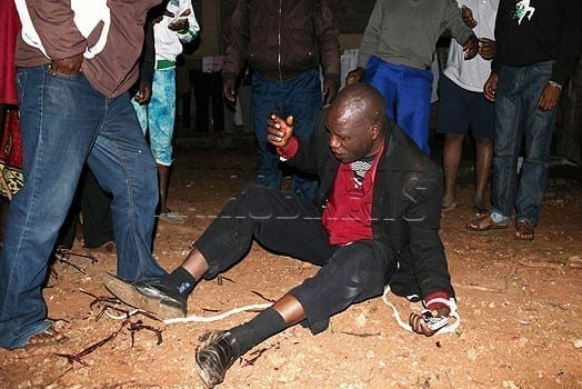 The preacher, Sammy Ndwiga, moments after he was beaten by the irate mob. PHOTO | CORRESPONDENT