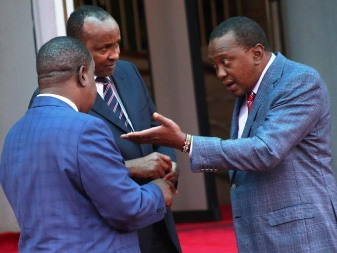 President Kenyatta with Interior CS Fred Matiang'i and MP-elect Aden Duale at Harambee House yesterday / HEZRON NJOROGE