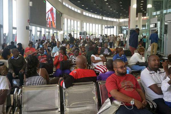 Passengers at the Mombasa terminus wait to board the Madaraka Express train