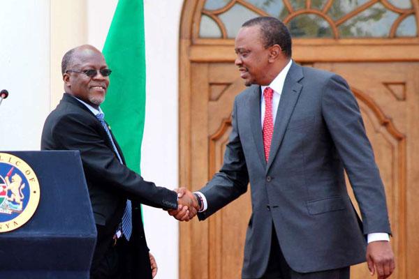Tanzania President John Magufuli (left) and his Kenyan counterpart Uhuru Kenyatta
