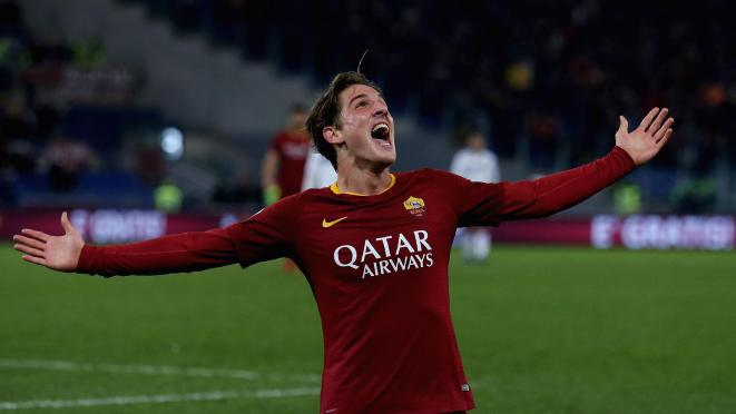 Nicolo' Zaniolo of AS Roma celebrates after scoring the team's third goal during the Serie A match between AS Roma and US Sassuolo at Stadio Olimpico on December 26, 2018