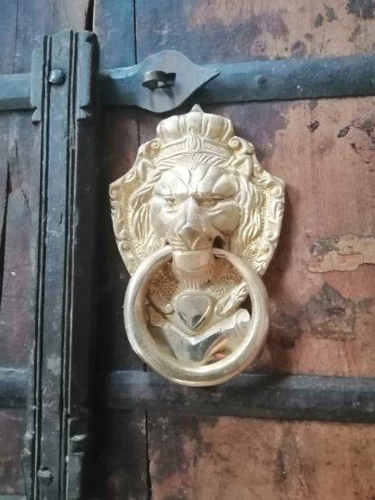 Brass door feature