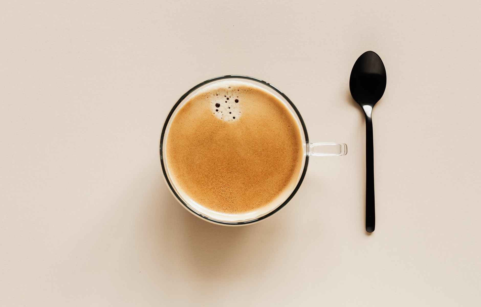 cup of coffee and spoon of table