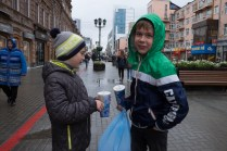 Ekaterinimburg, two guys are drinking Pepsi in the main street