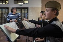 Students during a music's lesson, study military melodies