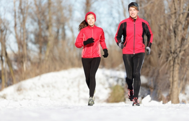 Sport couple running in winter