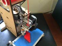 This is my Printrbot 3D printer. Modifications include 16 separate printed parts. Shown printing a calibration pyramid. Proper machine calibration is necessary for correct sizing and finish of 3d printed parts