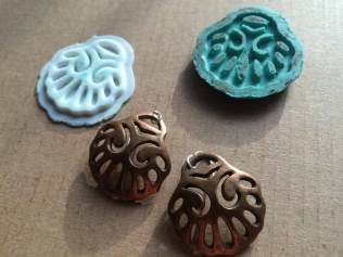 Here is a pair of finished bronze earrings, along with 3D printed model and mold.
