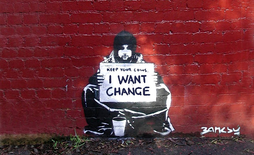 Political street art 'Keep your coins, I want change' by Banksy
