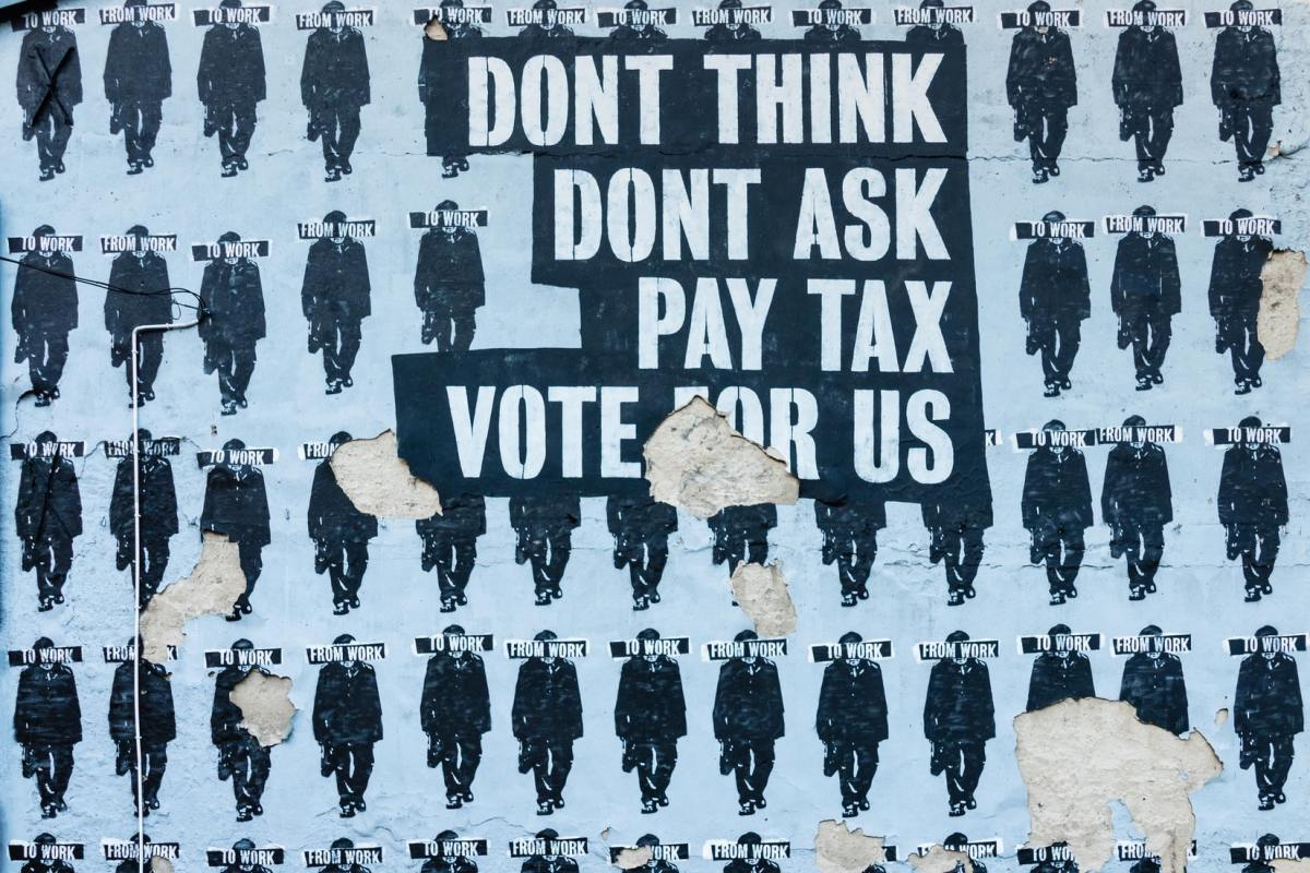Political street art Don't think, don't ask, pay tax, vote for us