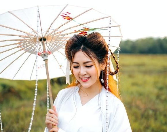 Chinese girl with a white umbrella