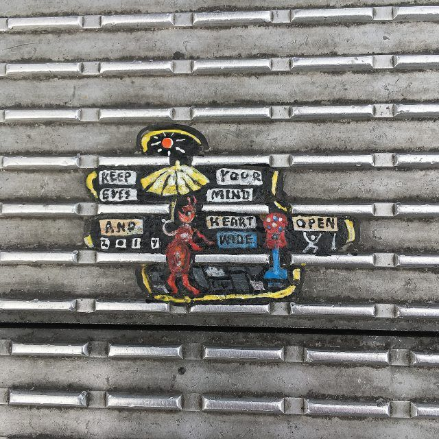 One of the tiny pieces of art painted on chewing gum on London's Millennium Bridge